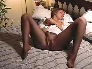 Mature housewife in stockings masturbate on bed