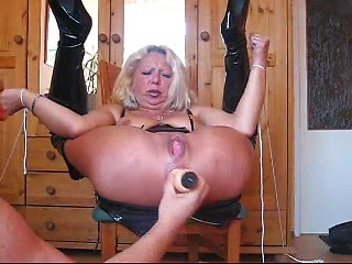 Roped mature German whore toy fucked in her...